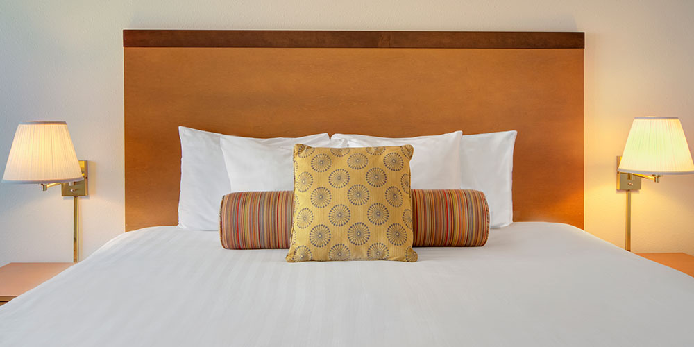 The deluxe room includes a pillow top king-size bed.