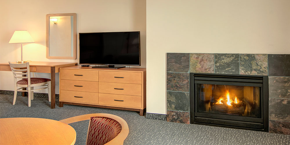 Each room has a cozy gas fireplace.
