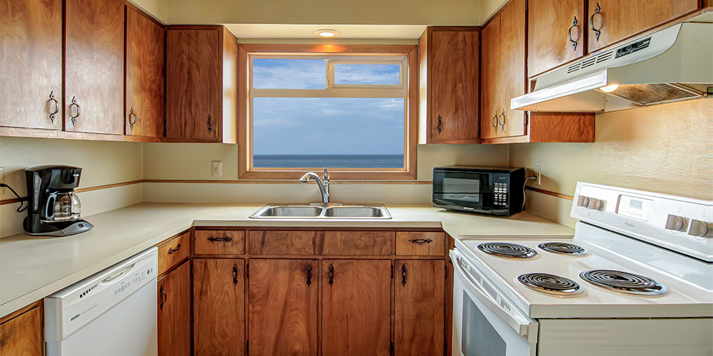 The fully functional kitchen has a full-range stovetop, microwave, and dishwasher.