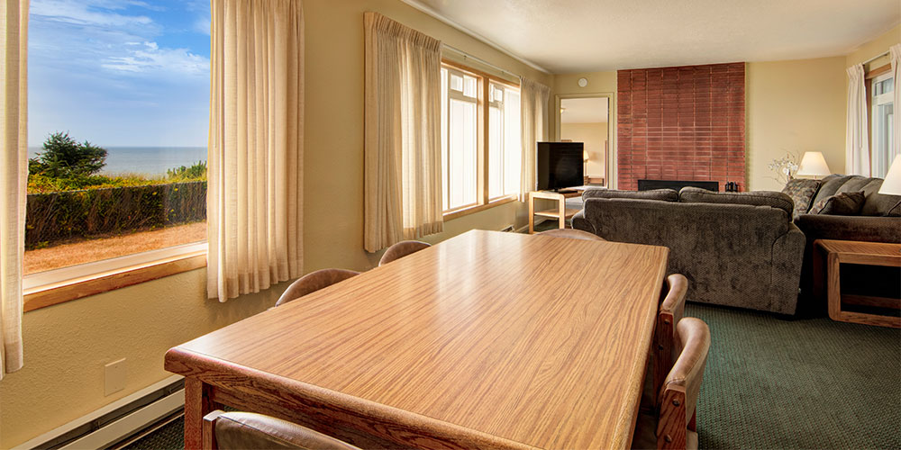 There is a large, six person dining room table in this beach house.